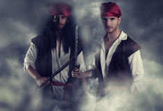 Two handsome young pirates. In the smoke Royalty Free Stock Images