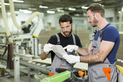 Two handsome young workers Royalty Free Stock Photos