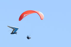 Two hang gliders fly close to each other royalty free stock images