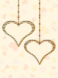 Two hanging heart shapes with copy space Royalty Free Stock Photos