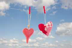 Two hanging red  hearts Royalty Free Stock Photo