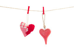 Two hanging red  hearts on white Royalty Free Stock Images