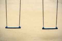 Two hanging swing seats on park Royalty Free Stock Photo
