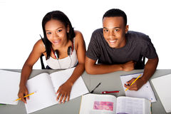 Two happy academic students studying together Royalty Free Stock Photos