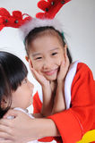 Two happy asian child in christmas costume hugging Royalty Free Stock Photography