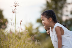 Two happy asian child girl having fun and playing with nature Stock Photo