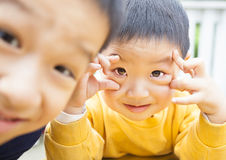 Two happy asian kids Royalty Free Stock Photos