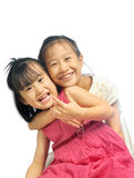 Two happy asian little sisters hugging, siblings love together Royalty Free Stock Photos