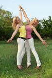 Two happy attractive blonde in white jeans Royalty Free Stock Photo