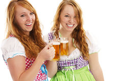 Two happy bavarian girls with beer. On white background Royalty Free Stock Images