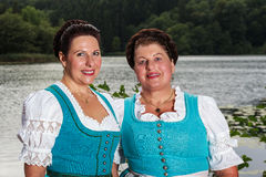 Two happy Bavarian ladies in dirndls Stock Photo