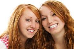 Two happy bavarian redhead girls. On white background Royalty Free Stock Photo