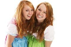 Two happy bavarian redhead women. On white background Royalty Free Stock Photo