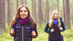 Two happy and beautiful girls walking in forest and swamps. Camp royalty free stock image