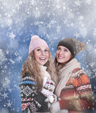 Two happy beautiful girls winter portrait Stock Images