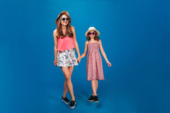 Two happy beautiful sisters smiling and walking together Royalty Free Stock Image