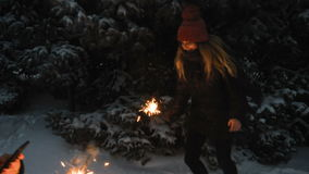 Two Happy beautiful Teen Girls having fun with sparklers in winter holidays.