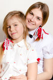 Two happy beautiful young woman and little girl wearing white blouses Royalty Free Stock Images