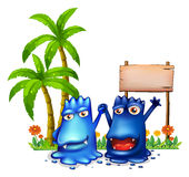 Two happy blue monsters in front of the wooden signage near the. Illustration of the two happy blue monsters in front of the wooden signage near the palm trees royalty free illustration