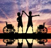 Two happy boy with a disability Stock Photos
