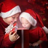 Two happy boy open  gift-box Stock Image