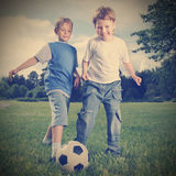 Two happy boy play in soccer Stock Photo