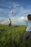 Two happy boy play in soccer Stock Photos
