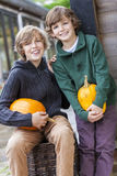 Two Happy Boys Brother With Pumpkins Royalty Free Stock Image