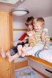 Two happy Boys In A Caravan Royalty Free Stock Photography
