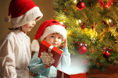 Two happy boys with christmas gift Stock Image
