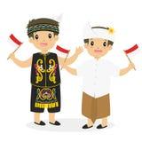 Dayak and Bali Kids Holding Indonesian Flag Cartoon Vector Stock Photography