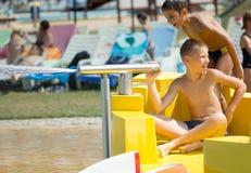 Two happy boys having fun in aqua park. Two boys having fun in aqua park Royalty Free Stock Photos