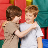 Two happy boys having fun in gym Royalty Free Stock Images