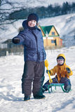 Two  happy boys on sled Royalty Free Stock Images