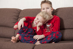 Two happy boys on the sofa Stock Images