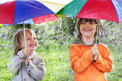Two happy brother with umbrella. Outdoors Stock Photography