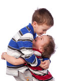 Two happy brothers hugging Stock Photos