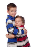 Two happy brothers hugging Royalty Free Stock Images