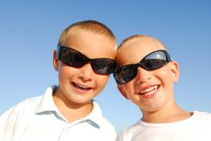 Two happy brothers on vacation. Two beautiful and cheerful brothers on summer vacation Stock Images