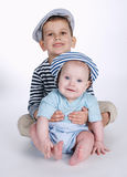 Two happy brothers on white background stock photography