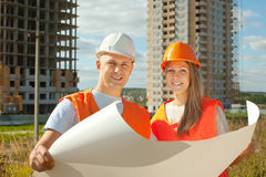 Two happy builders in hardhat Stock Image