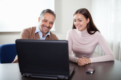 Two happy business colleagues working on laptop Royalty Free Stock Image