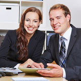 Two happy business people in office royalty free stock image