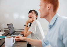 Two happy business people sitting at conference room Royalty Free Stock Photography