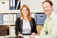 Two happy business people in their office royalty free stock photography