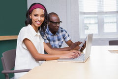 Two happy business people working together on a laptop Royalty Free Stock Photo