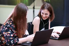 Two happy business woman working together stock photography