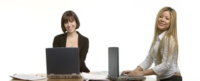 Two happy business women stock image