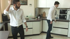 Two happy businessmen communicate in the kitchen in the office stock footage