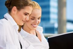 Two happy businesswomen with documents royalty free stock photo